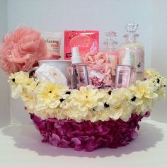 Send her this beautiful spa basket filled with a nice assortment of bath & body gift items,bath crystal, cup, bar soap, body lotion, soap rose petal, (2) spray body, bubble bath, sponge, lindt lindor milk chocolate with a smooth white filling. One of kind gift basket Vera-Mae Collection. All Handmade One of a kind Items may vary