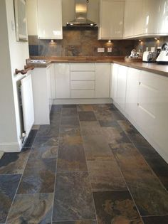 Image result for cream kitchen with black granite worktops chinese slate floor