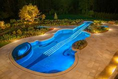 Ideas, Glamorous Swimming Pool In Stradivarius Violin Shape With Excellent Blue Lighting Surrounded By Spacious Paving Stone Beautiful Garde. Amazing Swimming Pools, Swimming Pool Lights, Luxury Swimming Pools, Swimming Pool Designs, Outdoor Swimming Pool, Cool Pools, Pool Spa, Pool Shapes, Water Features