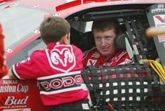 A (even younger) Chase Elliott chats with his famous father Bill before a race back in the day.