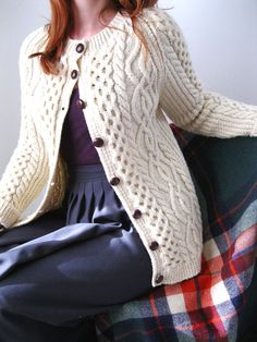 cabled sweaters, pleated skirts, plaid blanket...