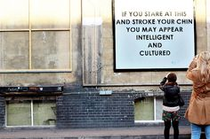 2012.04.15 - Bricklane, East london.  An interesting snapshot, a moment captured just in time. Two women (actually 3, if you include me) standing behind each other trying to capture a wall quote with their cameras.     http://www.renniyurib.com/blog/2012/04/17/brick-lane-london/