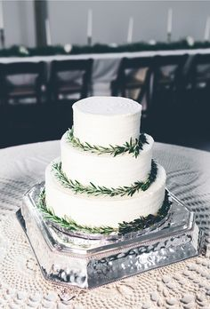 White tiered wedding cake with green accents. See more from this Nashville wedding with a vintage Southern theme and colors of white and cream at The Old School! Pics by @highfiveforlove | The Pink Bride® www.thepinkbride.com
