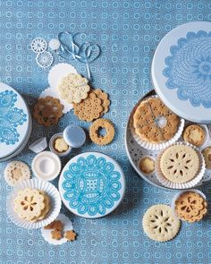 Using tiny aspic cookie cutters to make your cookies look like delicate doilies. Great for showers!