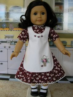 Vintage style dress and cross-over style apron with hand embroidered basket design - We purchased this sweet outfit from Tomi Jane at dolltimes on Etsy