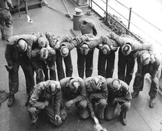 """US Marines with haircuts that spelled out """"VICTORY USMC"""" aboard a ship bound for the Marshall Islands invasion 1944."""