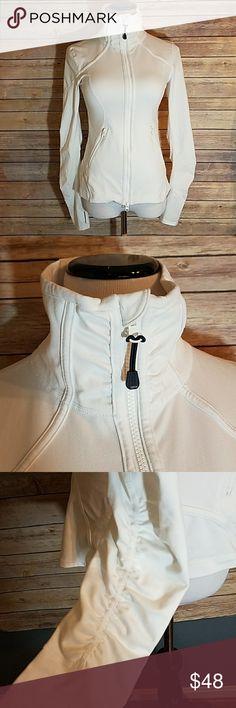 ZELLA White Ruffle Back Dual Zip Jacket Thumbholes ZELLA White Ruffle Back Dual Zip Stretch Soft Workout Jacket with Thumbholes. Just like Lululemon!  Size S Zella Tops