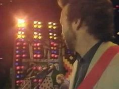 Dire Straits performing live with Eric Clapton at Wembley Stadium at Nelson Mandela 70th Birthday Party  11th June 1988. The Walk of Life    Enjoy!