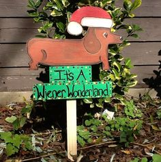 @Nicki Bohnett Christmas Dachshund , Wiener Dog, Lawn Ornament. $20.00, via Etsy.