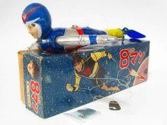 8 Man wind up toy.