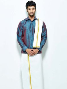 Phenomenal dark teal blue color #Raw #Silk #Shirt comes with white color cotton dhoti and angavastram. Item Code : SCU12002-19 http://www.bharatplaza.com/new-arrivals/south-indian-mens-wear.html