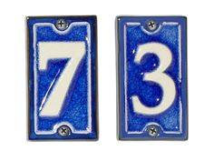 """French-style blue 4 1/4""""-tall ceramic house numbers, $19 each, rejuvenation.com"""