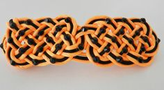Orange and Black Celtic knot irish dance hair clip by RinceCouture