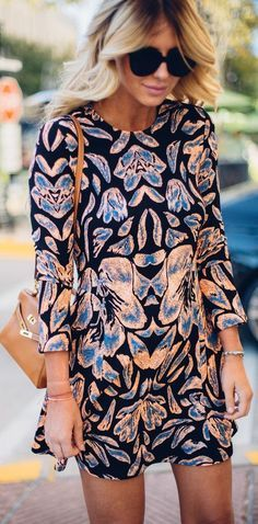 Short printed dress for spring. Blue and orange. Gorgeous design.