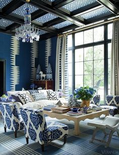 Floor-to-ceiling blue-based prints convey a spectacular statement.