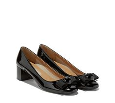 Mid heel pump featuring the iconic gros grain bow, Ferragamo logo on a spherical…
