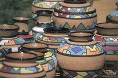 You can buy souvenirs in the tourist shops or you can negotiate a price for local art and crafts at roadside stalls in South Africa.