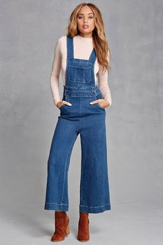 85e950c316 A pair of denim overalls featuring a wide leg