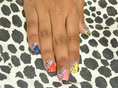 Funky coloured acrylic nails with leopard print by me