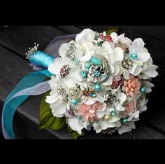 I'm sure you could get costume broaches in bulk from etsy or eBay. This is really cool!
