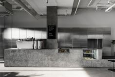Designed by local architect studio Ritz & Ghougassian, the Penta Cafe in Melbourne's Elsternwick is very raw and minimal. Industrial atmosphere with grey floors, concrete walls, terrazzo benche Cafe Interior Design, Simple Interior, Cafe Design, Design Art, Design Ideas, Graphic Design, Dark Interiors, Colorful Interiors, Tatto Shop