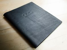 Black leather corporate custom presentation portfolio with blind debossed name.