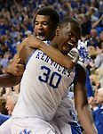 Kentucky Wildcats guard Andrew Harrison (5) tackles Kentucky Wildcats forward Julius Randle (30) at the win during overtime at the UK men's basketball game against LSU at Rupp Arena in Lexington, Ky., on Saturday, February 22, 2014. Photo by Caleb Gregg | Staff