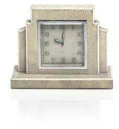 SHAGREEN & IVORY ART DECO STYLE CLOCK of stepped form, the face with arabic numerals, and marked Swiss Made 4¾in. (12cm.) high