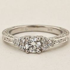 18K White Gold Adored Trio Diamond Ring. Set with a 0.42 Carat, Round, Super Ideal Cut, I Color, SI1 Clarity Diamond. #BrilliantEarth
