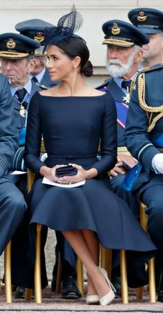 Meghan Duchess of Sussex attends a ceremony to mark the centenary of the Royal Air Force on the forecourt of Buckingham Palace on July 10 2018 in...