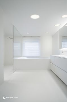 Bathroom Lighting - Wever & Ducré | Do you need a real highlight but have a low ceiling? Then CITY is the perfect room-mate. The trick: CITY has a very small mounting depth and the ceiling has to be lowered only marginally. So even low ceilings are no problem. The luminaire is available in three different sizes. Interior Design: Eva Carlier, Photographer: Kris Dekeijser