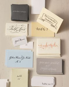 Hand-written escort cards, calligraphed in a variety of styles