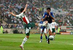 Italy 2 Bulgaria 1 in 2004 in Guimaraes. Milen Petkov and Bernard Corradi battle for the ball in Group C at Euro 2004.