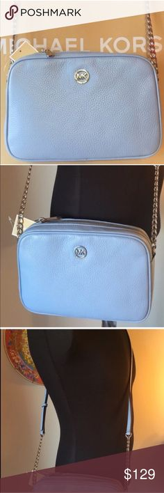 🆕MICHAEL KORS NEW ROOMY CROSSBODY 💯AUTHENTIC MICHAEL KORS NEW NEVER USED WITH TAGS ROOMY PEBBLE LEATHER CROSSBODY BAG 100% AUTHENTIC. NEW COLLECTION JUST RELEASED! STUNNING AND STYLISH. THIS IS THE LARGE SIZE OF THIS BAG. NOT THE MINI. BEAUTIFUL SHADE OF SKY BLUE WITH SILVER HARDWARE. THIS GREAT BAG HAS PLENTY OF ROOM WITH PADDED INTERIOR WALLS THAT CAN FIT MOST TABLETS TOO! IT HAS THREE ROOMY INTERIOR WALL POCKETS ! MEASURES NEARLY 10 INCHES WIDE BY NEWRLY 7 INCHES TALL IT HAS A LONG…