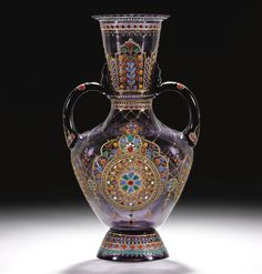 A J. & L. LOBMEYR GILDED AND ENAMELLED TWO-HANDLED SMOKEY BLUE GLASS VASE, SIGNED WITH MONOGRAM, VIENNA, LATE 19TH CENTURY