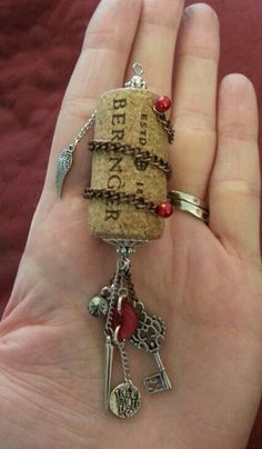 Wine cork necklace or whatever else you may use it for :) All you need is a cork, wire, jewelry findings, chain, charms and I used push pins to hold the chain to the cork. You can come up with your own creative design :)