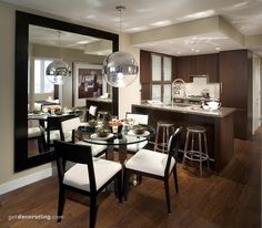 Dramatic kitchen with limited space, mirror adds so much dimension to the room!