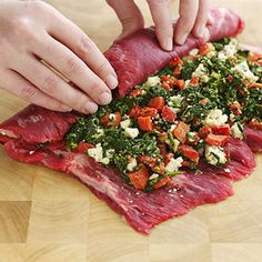 flank steak stuffed with spinach, blue cheese & roasted red peppers..........yummmmmmmm.....this will be made but im thinking with feta cheese and sun dried tomatoes and of course the spinach still. (:
