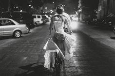 Leaving their wedding on a tandum bike, so cute!    Photo:  Geoff Duncan