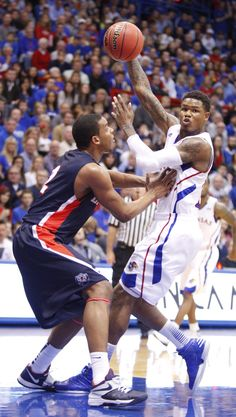 Kansas guard Ben McLemore dishes a pass over his shoulder as he is defended ~ 12.15.12