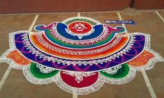 Latest Beautiful Diwali Special Rangoli Collection - Live Enhanced Explore the Latest Beautiful Special Rangoli Collection at Live Enhanced.visit for more ideas and decoration tips specially for Diwali Festival. Rangoli Colours, Rangoli Patterns, Rangoli Ideas, Rangoli Designs Diwali, Diwali Rangoli, Indian Rangoli, Easy Rangoli, Diwali Craft, Simple Rangoli Designs Images