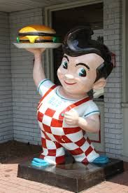 In 1936, Bob Wian purchase a small hamburger stand called Bob's Pantry. In 1937 the first double-decker hamburger was born. Customers couldn't get enough of it; one fan in particular was a chubby six year old boy in droopy overalls.  He would help Bob sweep up in exchange for a free burger. In honor of his young friend, Wian decided to name the Big Boy. Another regular customer, a movie animator, sketched the character on a napkin & Bob's Big Boy was born.