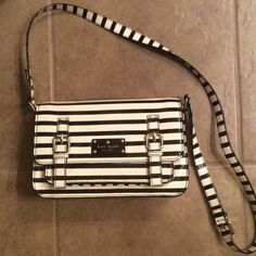 Kate Spade Scout Flicker Handbag EUC.  Only used once.  Black and cream patent stripe with fun inside print. kate spade Bags Crossbody Bags