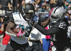 Raiders vs. Jaguars:     October 23, 2016  -  33-16, Raiders  -    Oakland Raiders free safety Reggie Nelson (27)  grabs Jacksonville Jaguars running back Chris  Ivory (33) by the face mast on a run during the  second quarter of an NFL football game Sunday,  Oct. 23, 2016, in Jacksonville, Fla. (AP  Photo/Stephen B. Morton)