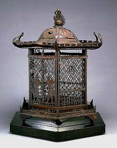 Hanging Iron Lantern, Kamakura Period, (Dated 1319)  Donated by Mr. Soichiro Suzuki  Important Cultural Property  EK 48  Kyoto National Museum. From the openwork inscription, it is known to be the oldest dated hanging lantern in Japan. This lantern was made by Sadasumi of Owari Province, and was formerly owned by Choryoji temple in Hakusan.