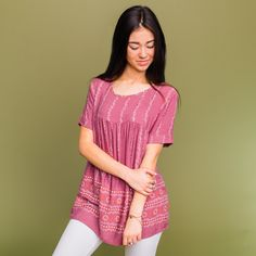 """Lightweight baby-doll textured print top with short sleeves and scoop neckline Approximate bust measurement: Small - 38""""      Medium - 40""""      Large - 42"""" Approximate length: Small - 27.5"""" Medium - 28.5"""" Large - 29.5"""" Fabric content: Rayon"""