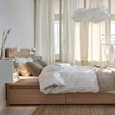 A bed with drawers underneath is a great way to get some extra storage space