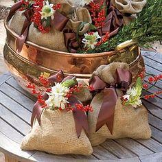 Brown silk ribbon, berries, greenery and flowers on burlap gift bags.   #WoodlandChristmas #WoodlandEaster