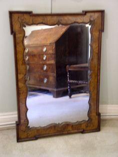 walnut and parcel gilt wall mirror