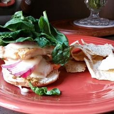 Chicken sandwich with red onion spinach cheddar and spicy mustard